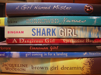 Spine Poem of Novels in Verse: A girl named Mister borrowed names/ Shark Girl / A Dangerous Girl / Cinnamon Girl /Girl Coming in for a Landing / Brown Girl Dreaming (by Sarah Tregay)