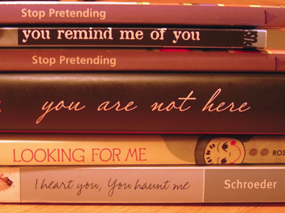 Spine Poem of Novels in Verse: Stop pretending / you remind me of you. / Stop pretending / you are not here looking for me. / I heart you, you haunt me. (by Sarah Tregay)