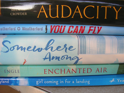 Spine Poem of Novels in Verse: Audacity, you can fly / somewhere among enchanted air / girl coming in for a landing. (by Sarah Tregay)